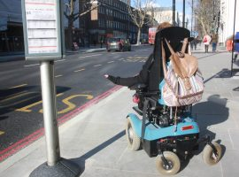 Emma Vogelmann in her wheelchair waiting for a bus