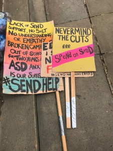 Placards from the SEND march